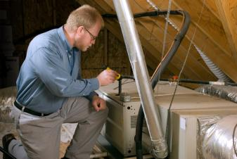 Broomfield furnace repair specialist works on a Carrier furnace installed in an attic