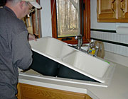 plumbing contractor installing a new kitchen sink